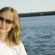 Pretty girl on the lake background — Stock Photo #2674325