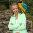 Girl portrait with parrot — Stock Photo