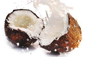 Cracked coconut with splash — Stockfoto