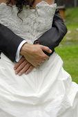 Groom embrace his bride — Stock Photo