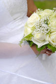 Bride holding hers bouquet — Stock Photo