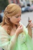 Woman applying make up — Stock Photo