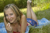 Nice girl on the grass-plot — Stock Photo