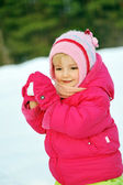 Girl in plays with snow — Stock Photo