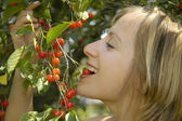 Nice girl in the garden with cherry — Stock Photo