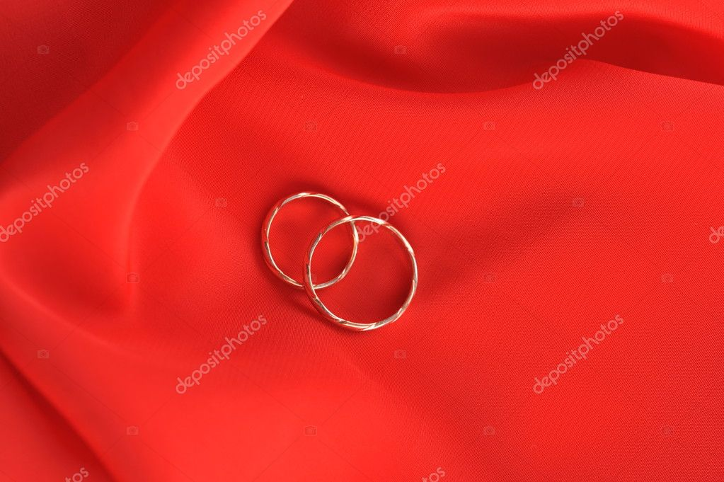 Wedding rings on red background  Stock Photo #2673595