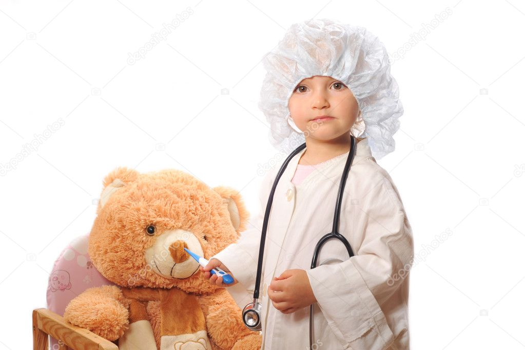 Small beautiful girl playing doctor and healing taddy bear — Stock Photo #2674432