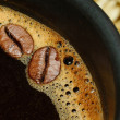 Stock Photo: Black coffee cup and coffee beans