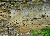 Traces of bullets on wall — Stock Photo