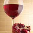 Royalty-Free Stock Photo: Pomegranate and glass of red wine.