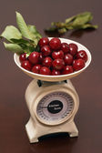 Cherry on the kitchen scale — Stock Photo