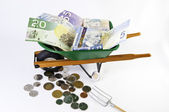 Canadian dollars in wheel barrel — Stock Photo