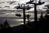 Sunset ride on the chairlift — Stock Photo