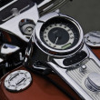 Stock Photo: Motor cycle speedometer and gas tank.