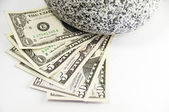 US 1,5,50 dollar bill and a rock — Stock Photo