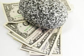American money under a rock — Stock Photo