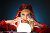 Fortune-teller with a shining crystal ball — Stock Photo