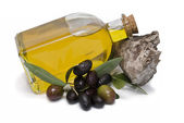 Olive oil bottle and olives. — Stock Photo