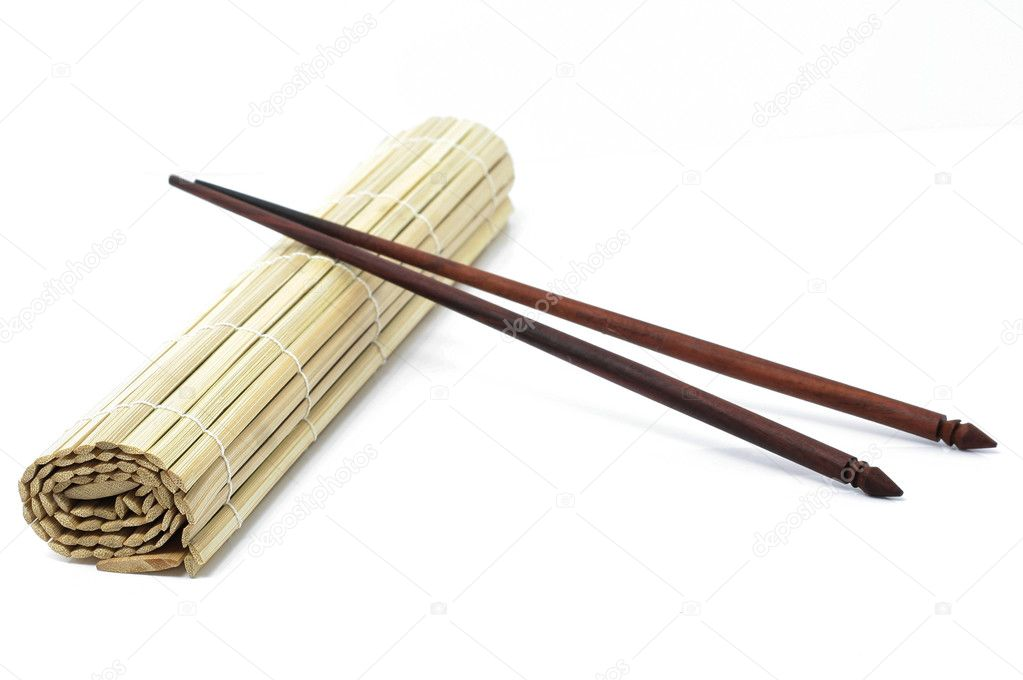 Sushi mat and chopsticks  — Stock Photo #2660080