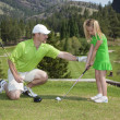 Father and Daughter Golf Lesson - Stock Photo