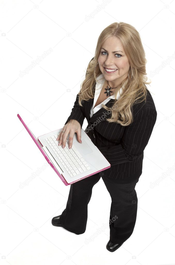 Full length studio photo of woman holding laptop computer, looking up at camera. White background.  Stock Photo #2662881