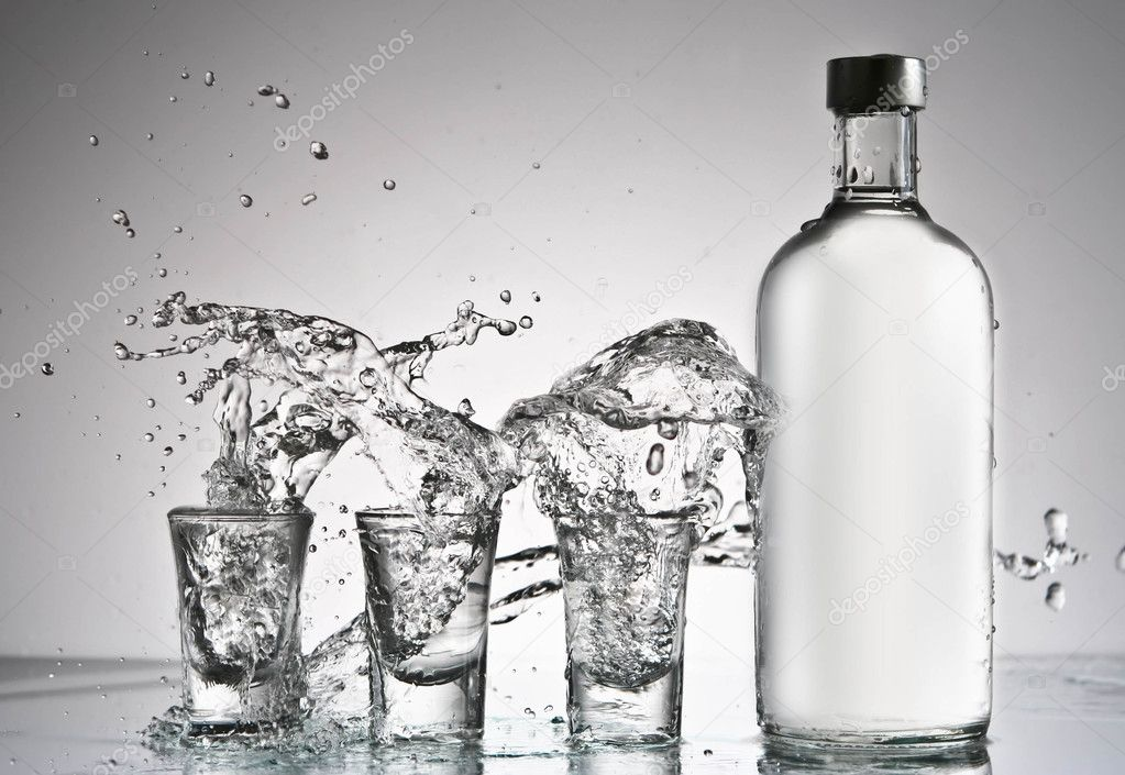 Bottle of vodka and glasses splash  Stock Photo #2658406