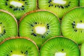 Kiwi slices background — Stock Photo