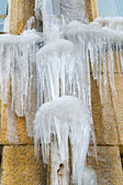 Icicles on gutter — Stock Photo