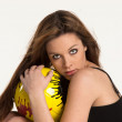 Young girl with a yellow ball — Stock Photo