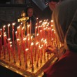 Prayer lightning candle in church — Stockfoto