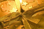 Christmas gift box. Gold color — Stock Photo