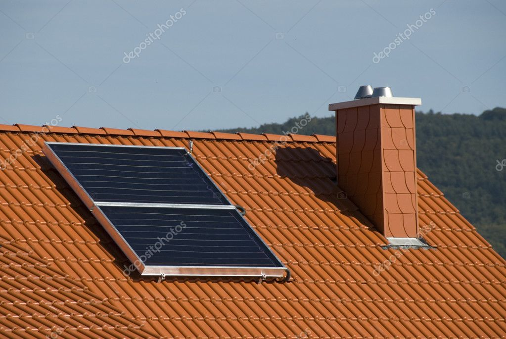 Solar collectors in a modern ecological house — Stock Photo #2655715