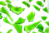 Green glass broken into slices — Stock Photo