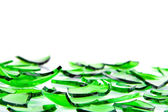 Green glass broken into slices — Stock Photo