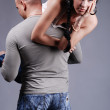Strong man holding bored young woman on — Stock Photo #2605442