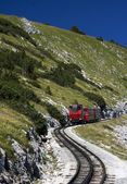 Red train in the mountains — Stock Photo