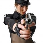 Beautiful policewoman aiming a gun — Stock Photo