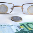 Royalty-Free Stock Photo: Abstract eye-glasses coins and banknote