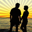 Romantic pair looking at each other at sunset — Stock Photo #2668584