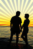 Romantic pair looking at each other at sunset — Stock Photo