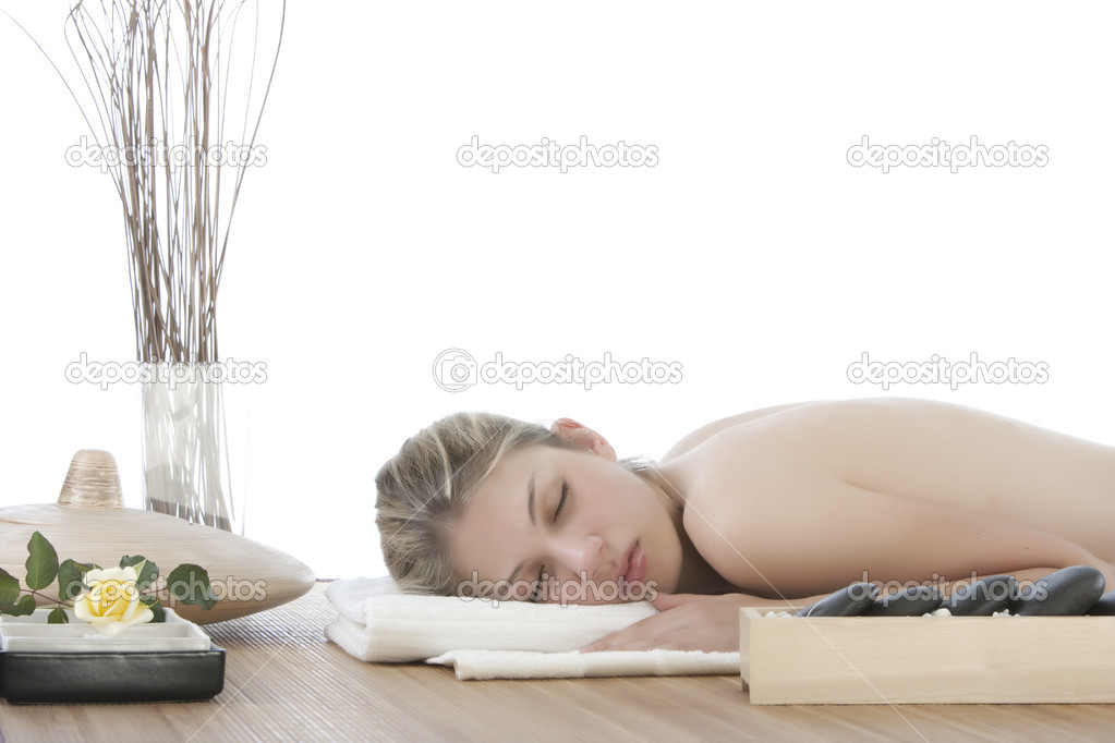 Cute girl getting a stone massage in a spa — Stock Photo #2684189