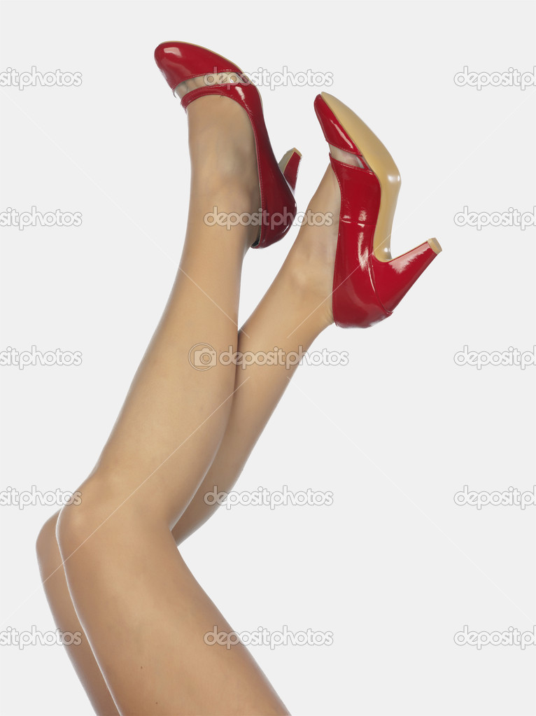 Beautiful legs in red shoes — Stock Photo #2687904