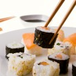 Picking up a sushi roll — Stockfoto