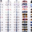 Stock Photo: Eyeglasses display shelves