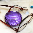 Artificial gem and eyeglasses - Stock Photo