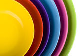Colored plastic bowls — Stock Photo