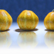 Three yellow pumpkins — Stock Photo