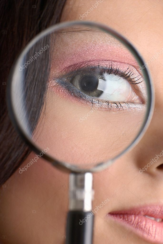 Girl looking through the magnifying glass — Stock Photo #2649538