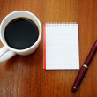 Pen, notebook and coffee — Stock Photo