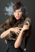 Cigar and lady — Stock Photo